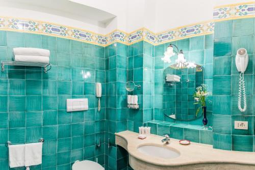 A bathroom at Hotel Poseidon