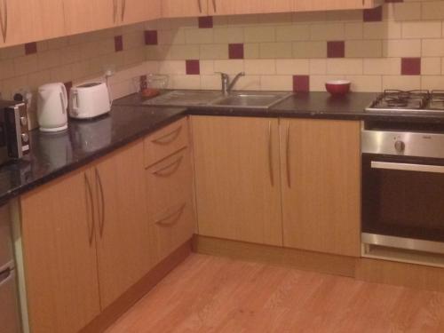 Una cocina o zona de cocina en Nky Apartment