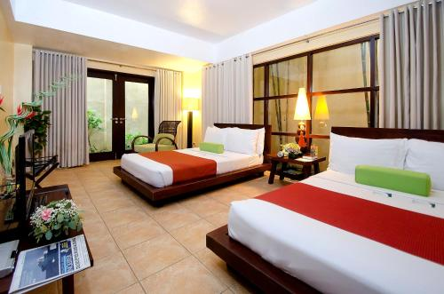 A bed or beds in a room at Canyon de Boracay