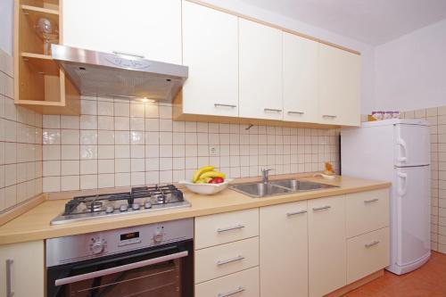 Kuchyňa alebo kuchynka v ubytovaní Apartments Imgrund