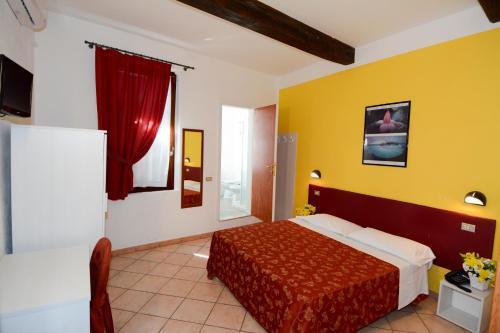 Un ou plusieurs lits dans un hébergement de l'établissement Abc Comfort Hotel Mantova City Centre