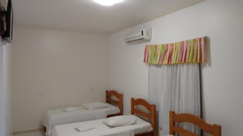 A bed or beds in a room at Pantanal Norte Hotel