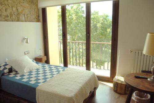 A bed or beds in a room at El Lacayo de Sestiello