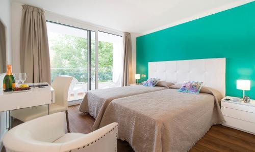 Cama o camas de una habitación en Apartamentos Miramar 1