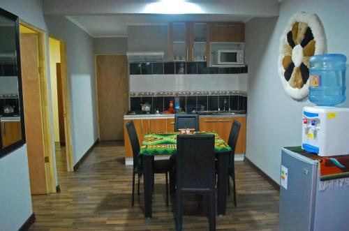 A kitchen or kitchenette at Cabañas Kirckir
