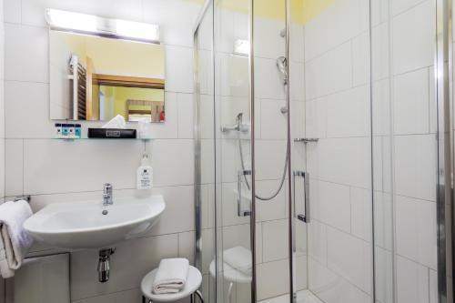 Ein Badezimmer in der Unterkunft Hotel Kasserolle