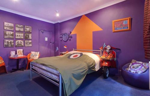 Letto o letti in una camera di Hotel Pelirocco