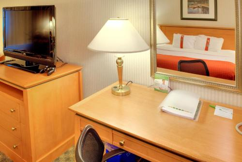A television and/or entertainment center at Holiday Inn North Vancouver, an IHG Hotel
