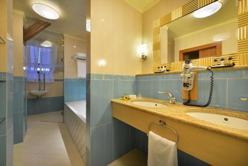 A bathroom at Zvon Design Suites