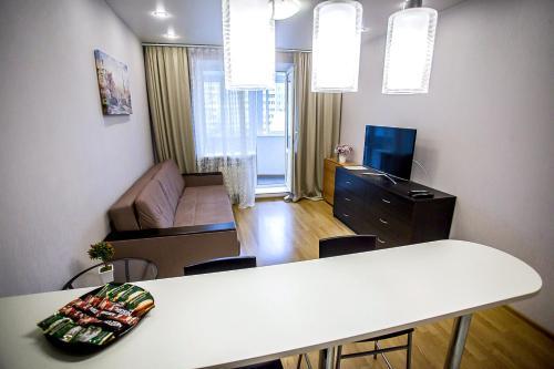 Телевизор и/или развлекательный центр в Апартаменты Позитив