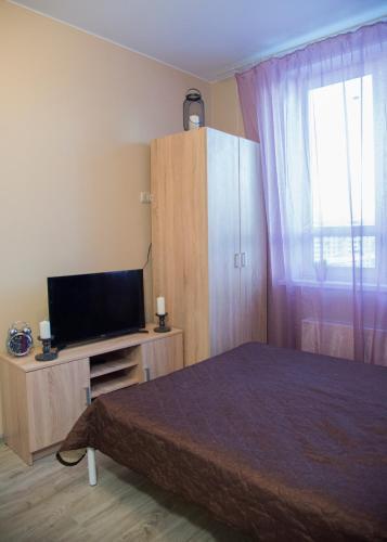Кровать или кровати в номере Ваша Зона Комфорта на Проспекте Астрахова 6 Студия Токио
