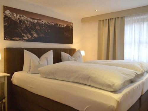 Ein Bett oder Betten in einem Zimmer der Unterkunft Haus Florence