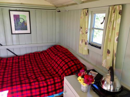 A bed or beds in a room at Shepherd's Hut
