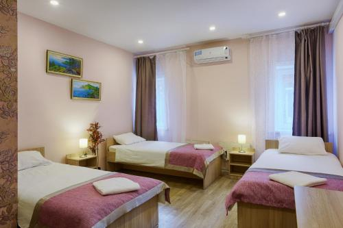 Кровать или кровати в номере Yakovlev hotel