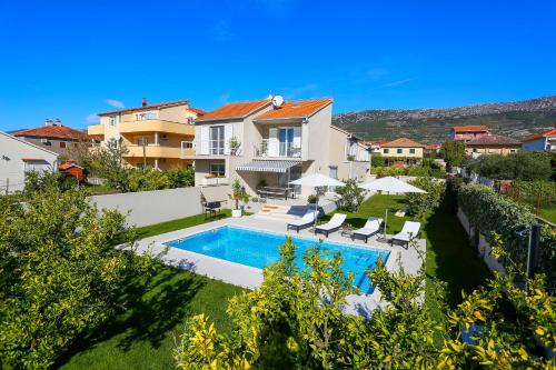 A view of the pool at Villa Elysium - beautiful house with heated pool or nearby