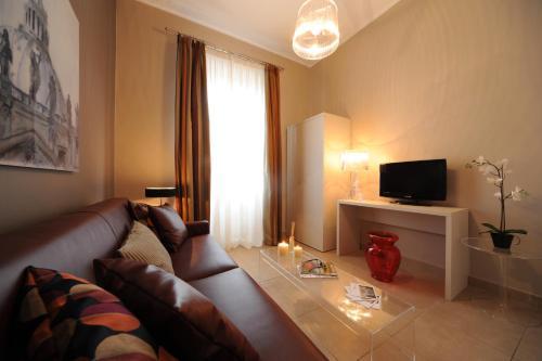 Uma área de estar em Trianon Borgo Pio Aparthotel