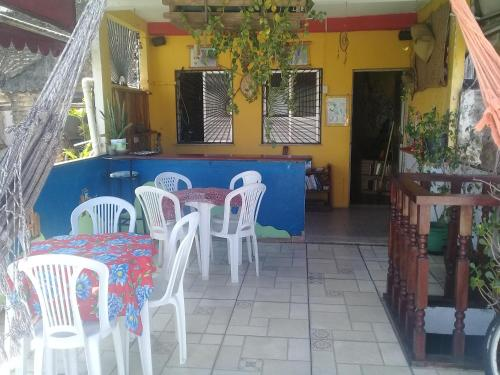 A restaurant or other place to eat at Nega Maluca Guesthouse