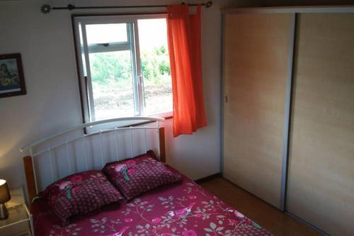 Cama ou camas em um quarto em Otemanu Ninamu Fare