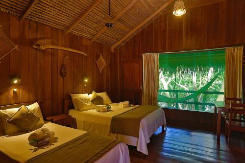 Ein Bett oder Betten in einem Zimmer der Unterkunft Juma Amazon Lodge