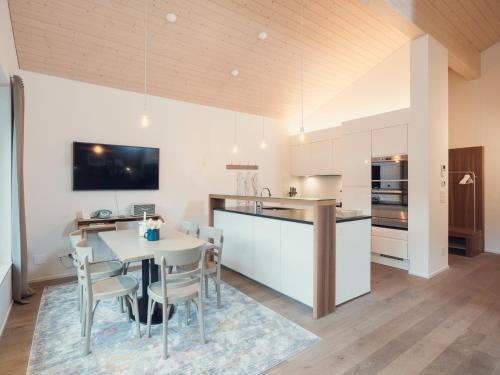 A kitchen or kitchenette at OVERLOOK Lodge by CERVO Zermatt