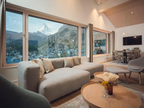 A seating area at OVERLOOK Lodge by CERVO Zermatt