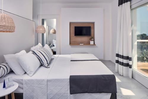 Łóżko lub łóżka w pokoju w obiekcie Archipelagos Hotel - Small Luxury Hotels of the World