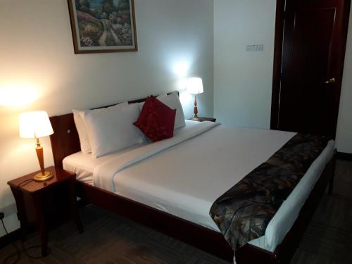A bed or beds in a room at Bintang Apartment Times Square At KL