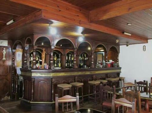La sala de estar o bar de Hotel y Restaurant Don Quijote