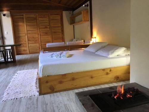 Uma cama ou camas num quarto em Residencial Warabi