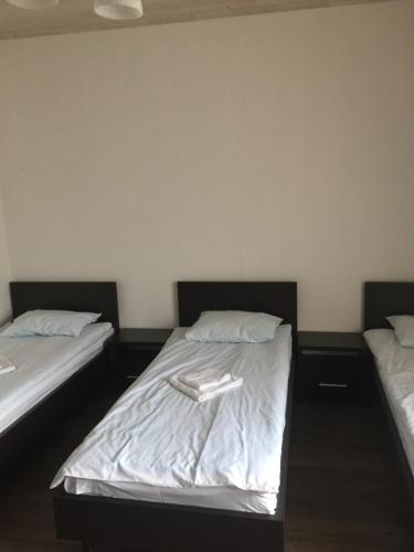 Кровать или кровати в номере Mini-hotel Megora