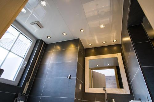 Een badkamer bij Luxe B&B Het Colmerhof