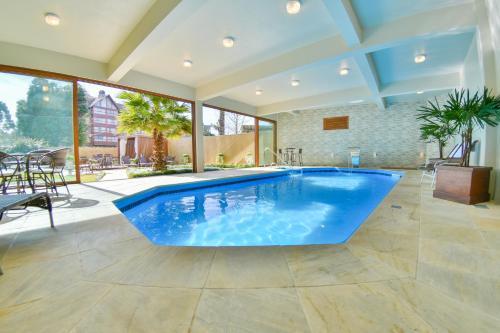The swimming pool at or close to Pousada Ares da Serra