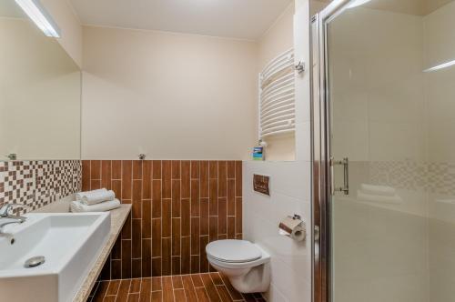 Ванная комната в Mikołajki Resort Hotel & Spa Jora Wielka