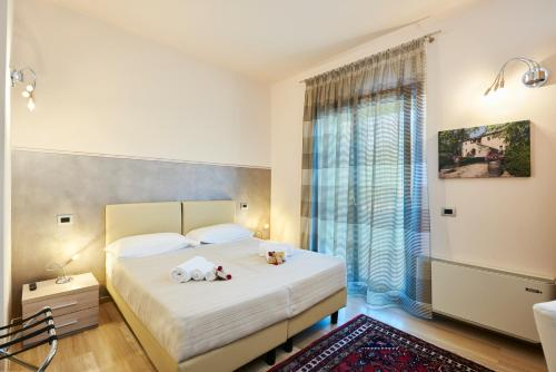 A bed or beds in a room at Domus Il Palio