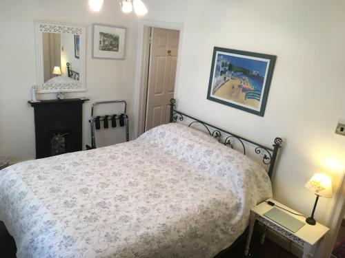 A bed or beds in a room at Southford House (Room Only)