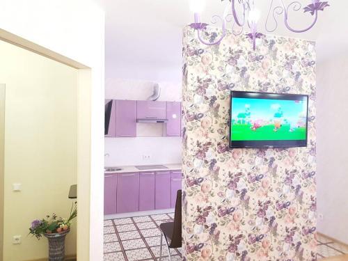 Телевизор и/или развлекательный центр в Apartments Уеs
