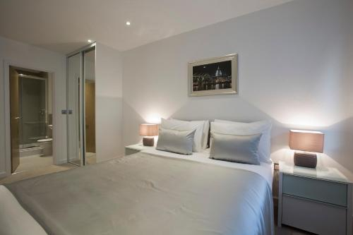 A bed or beds in a room at O2 Arena Apartments