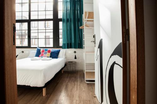 A bed or beds in a room at Koba Hostel