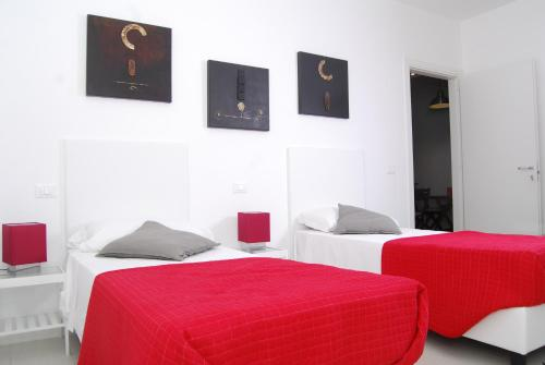 A bed or beds in a room at Casale Mammarella
