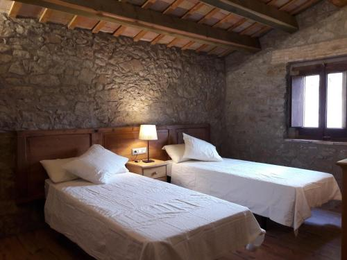 A bed or beds in a room at Mas Roca Del Mill