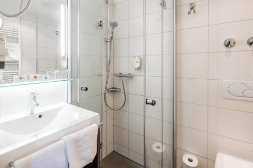 Ein Badezimmer in der Unterkunft Akzent Hotel Frankenbrunnen