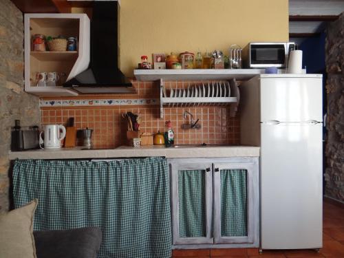 Una cocina o zona de cocina en La Remulla
