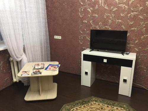 Телевизор и/или развлекательный центр в Apartment on Truhanova