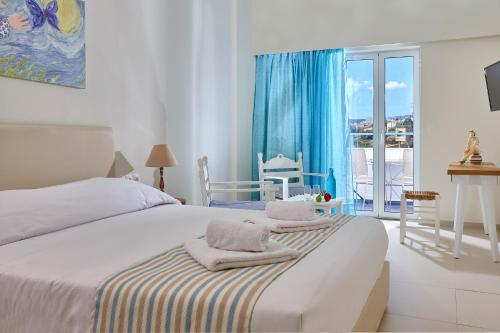 A bed or beds in a room at Vasia Ormos Hotel (Adults Only)
