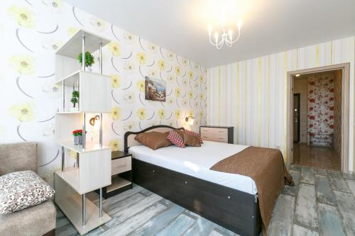 Кровать или кровати в номере Apartment on Lunacharskogo 5