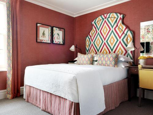 A bed or beds in a room at Knightsbridge Hotel, Firmdale Hotels