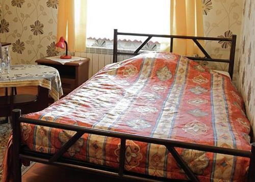 A bed or beds in a room at Hotel Miły