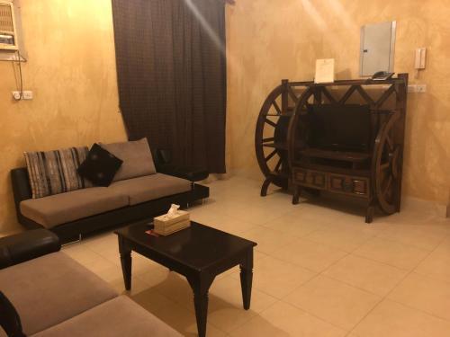 Uma área de estar em Golden Prince Hotel Al Salam