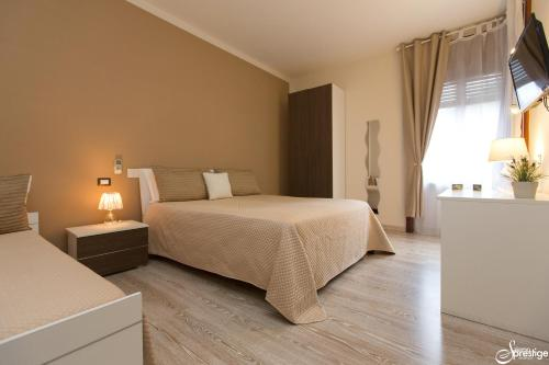 A bed or beds in a room at Salernoprestige