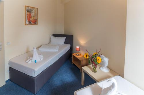 A bed or beds in a room at Hotel Comenius